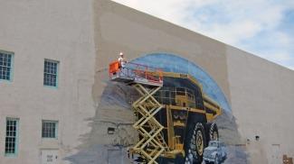 AMMM signage removal. Photo courtesy of Harvey Jong.