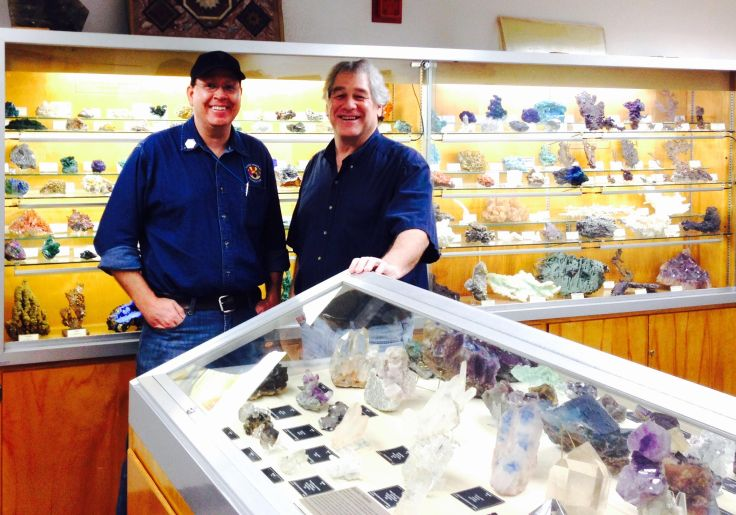 UAMM, Chris Whitney-Smith with Dr. Bob Downs in front of Flagg Mineral Foundation mineral collection.